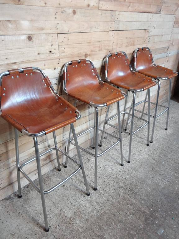 Stunning set of four stools, designer Charlotte Perriand used these in the Ski Resort Les Arcs, circa 1960. These stools were commissioned to be made by Cassina, one of the best Italian furniture maker's very nice chrome tubular frame with thick