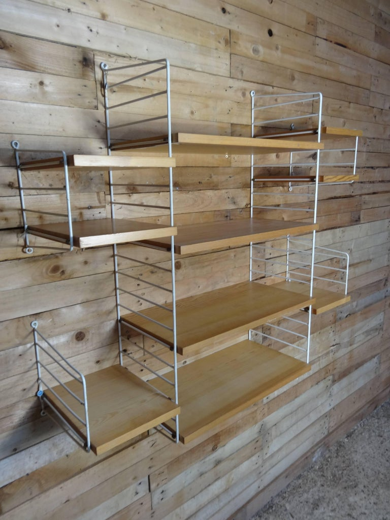 Large wall shelving unit by Nisse Strinning for String, 1960s. The string wall system was designed in 1949 and over the years has evolved from being innovative to one of the staples of Scandinavian design. Each component of the system is well