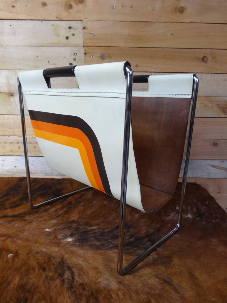 Leather and chrome magazine rack by Brabantia Holland.