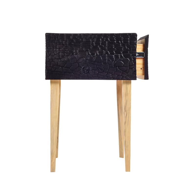 Charred Geometric Commode, Edition of 25. Here our single drawer modern interpretation of the traditional bedroom mainstay is rendered in charred Loblolly Pine; with mitered edges, the undulating texture wraps the case in deep color. As a counter
