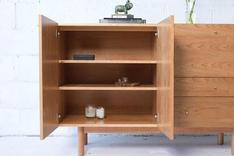 Rex Sideboard in Cherry-wood with Hand Spun Gold Pulls and Drop-down Mirror In New Condition For Sale In Brooklyn, NY