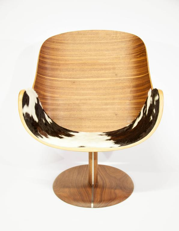 The you lounge is constructed through a series of complex bent laminations and employs tapered veneers to create