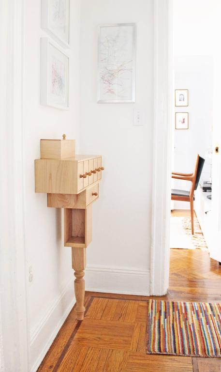 The Entry Console by Pelle was initially created for the designers' own narrow apartment hallway where space was limited, but the need for storage great. Despite its playful and whimsical exterior, the entry console offers serious interior storage