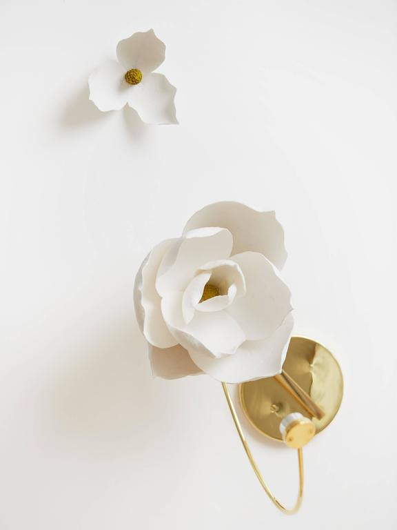 Each blossom a unique, delicate arrangement. At once open and closed, the flower's light and shadow lure one into its contemplative depths.   Lure transforms a flower's transient beauty into a lasting light. In this fixture, a cast paper flower is