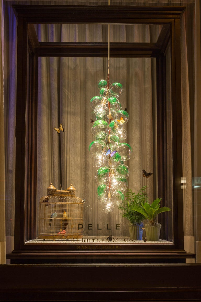 Ethereal and iconic, the Bubble chandelier is a modern re-interpretation of the crystal chandelier. Its luminous constellation of delicate glass globes adds beauty and depth to any interior environment.  Based on an original design first conceived
