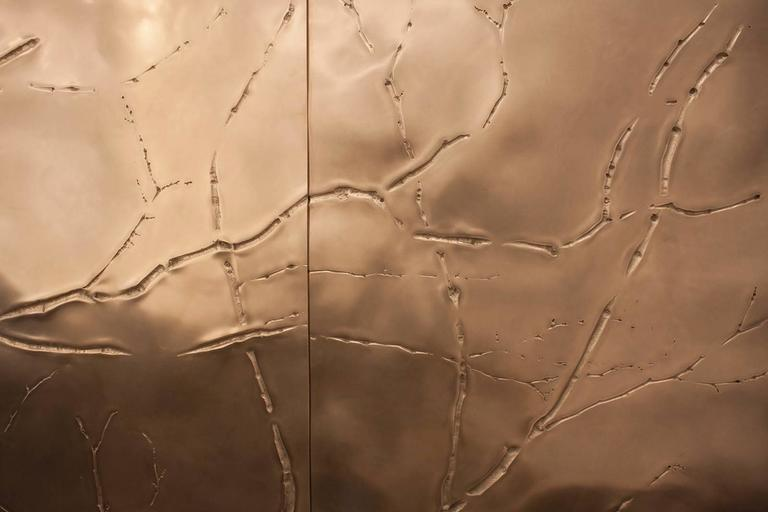 Of unparalleled stature and rarefied beauty is this bronze surface art which features the high texture of branches in relief against austere atmospherics of a polished undulating field. The countering natures in this Minimalist vocabulary create