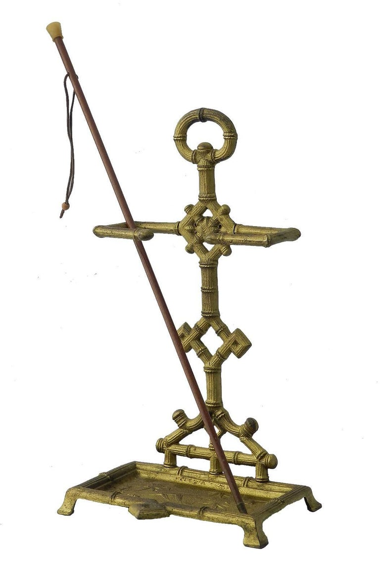Diminutive Stick Stand Cast Iron Faux Bamboo Aesthetic revival Chinoiserie Ideal for a stick collector For floor or stand on table top display Great for swagger sticks and batons as well as walking sticks Embossed chinoiserie bird and
