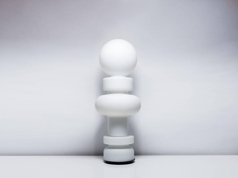 Impressively scaled mid-height floor lamp comprised of three pieces of milky-white glass. Designed by artist and theorist Bobo Piccoli for Fontana Arte in 1968, the