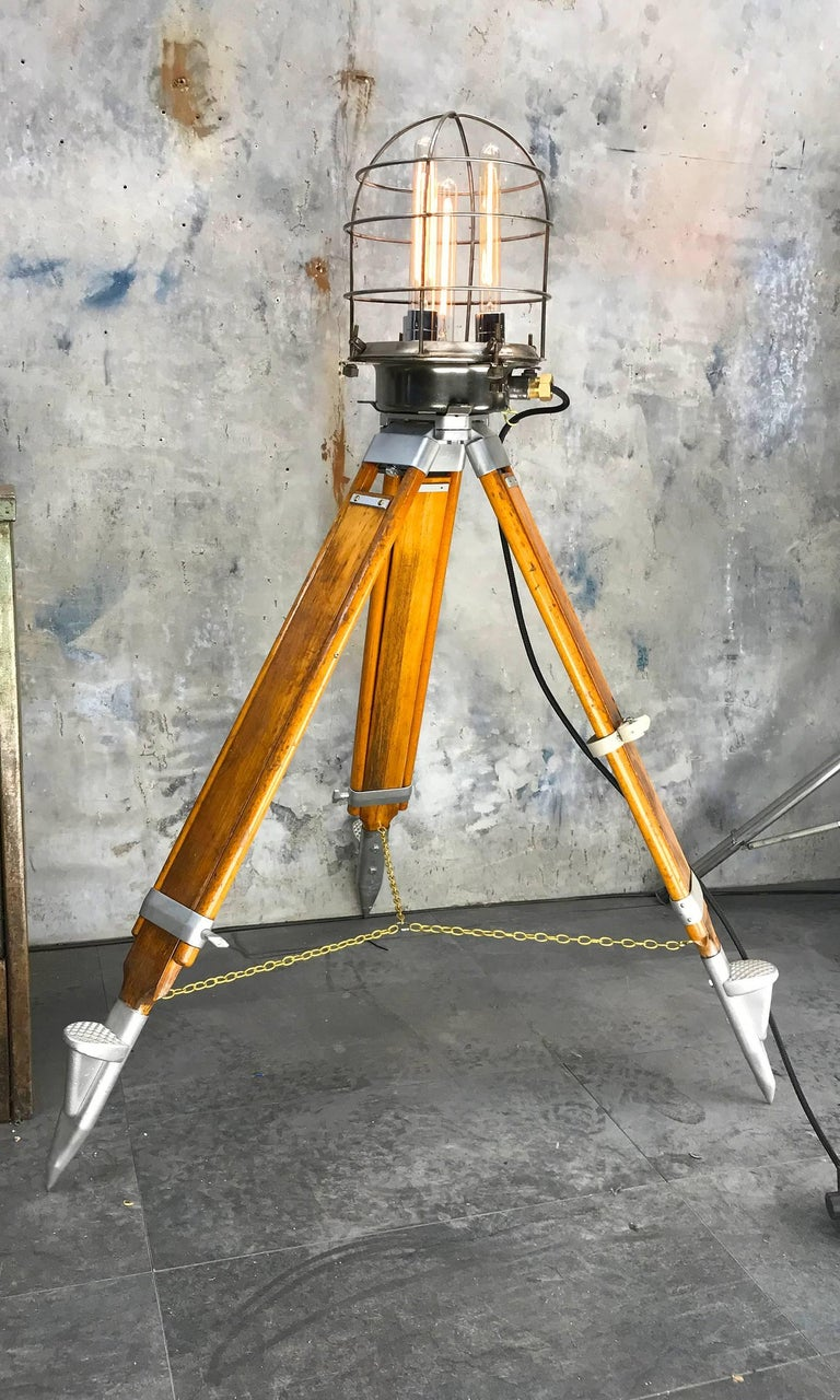 Unique Steampunk style tripod lamp with four Edison filament bulbs.