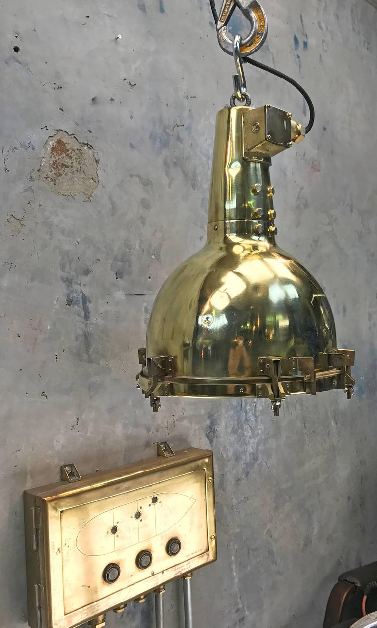 This substantial brass Industrial ceiling light fitting was salvaged from an old Japanese cargo ship built during the 1970s and restored by Loom light in the UK. We have expertly converted the search light to be a pendant for down lighting areas