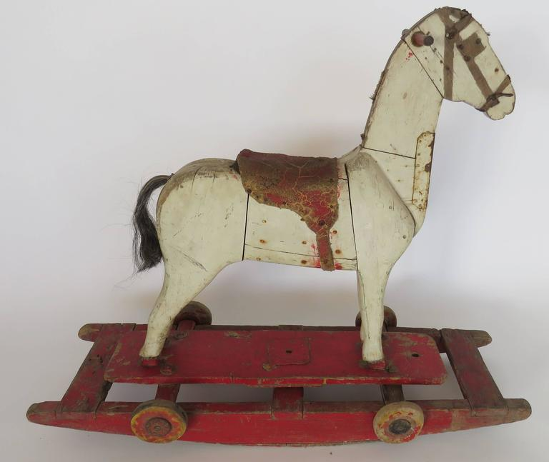 French 19th Century Wooden Rocking Horse For Sale