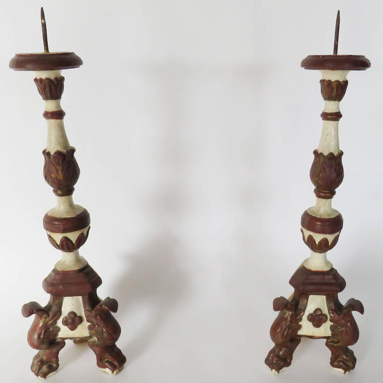 Each with wax pan raised on a twisted standard ending on three arched strap supports.