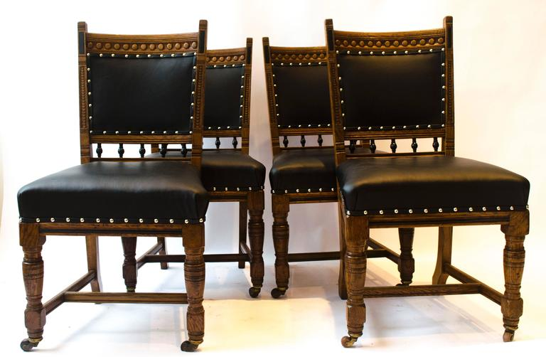 English Lambs of Manchester A Set of Four Aesthetic Movement Oak & Leather Dining Chairs For Sale