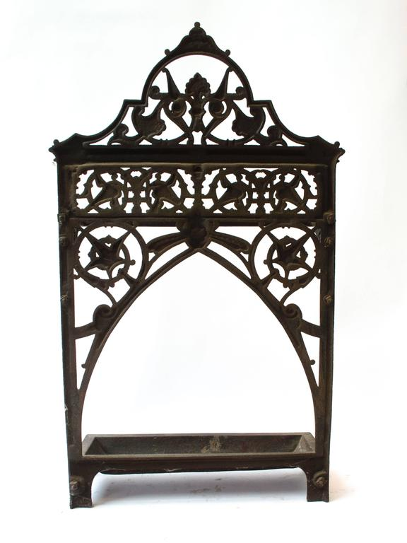 Dr C Dresser An Aesthetic Movement Cast Iron Stick Stand with stylised floral details.  Made By Coalbrookdale Iron Works. (The width is measured to the edges of the little lions paw feet).