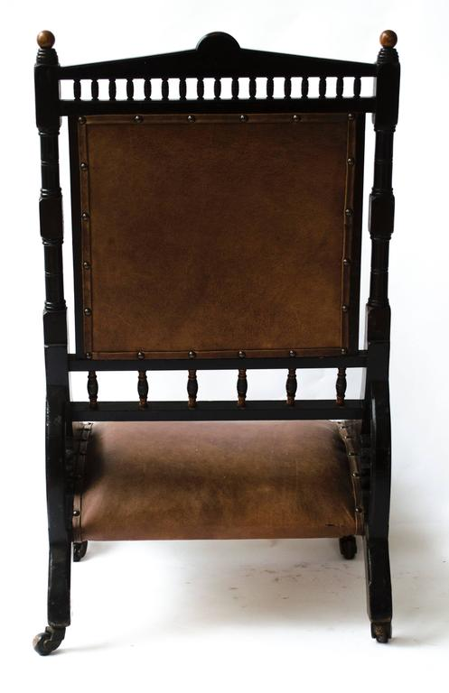 Richard Charles An Aesthetic Movement Ebonized and Parcel Gilt Lounge Chair. In Good Condition For Sale In London, GB