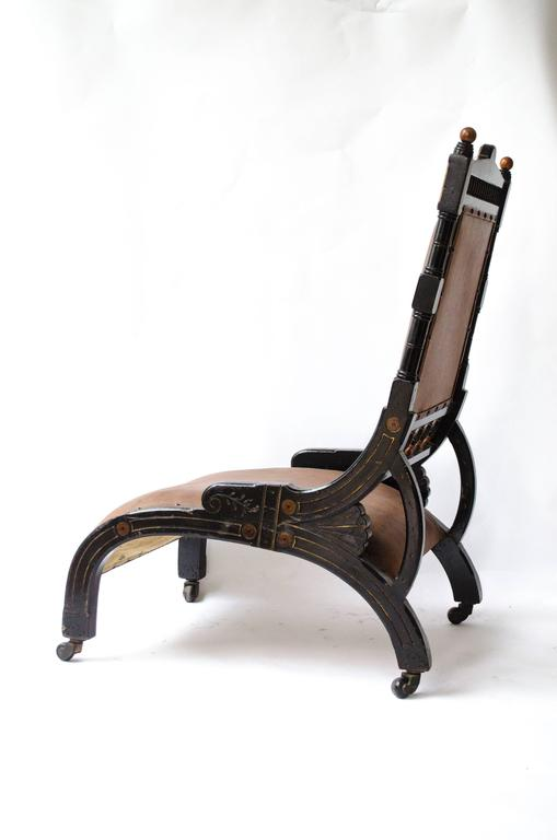 English Richard Charles An Aesthetic Movement Ebonized and Parcel Gilt Lounge Chair. For Sale