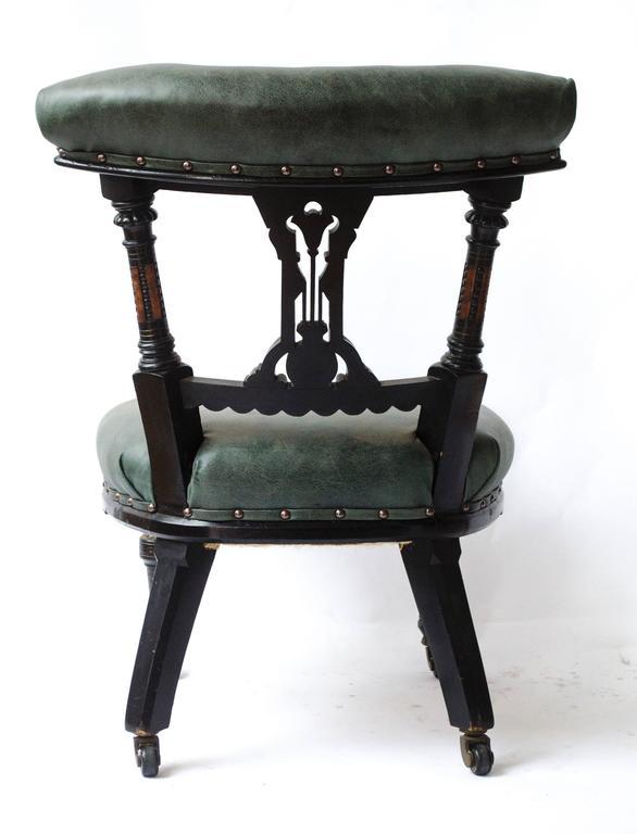 English Ogdens Of Manchester. An Aesthetic Movement Ebonized & Parcel Gilt Nursing Chair For Sale