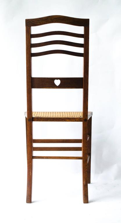 Arts and Crafts Shapland & Petter An Arts & Crafts Inlaid Oak Side Chair with a Pierced Heart For Sale