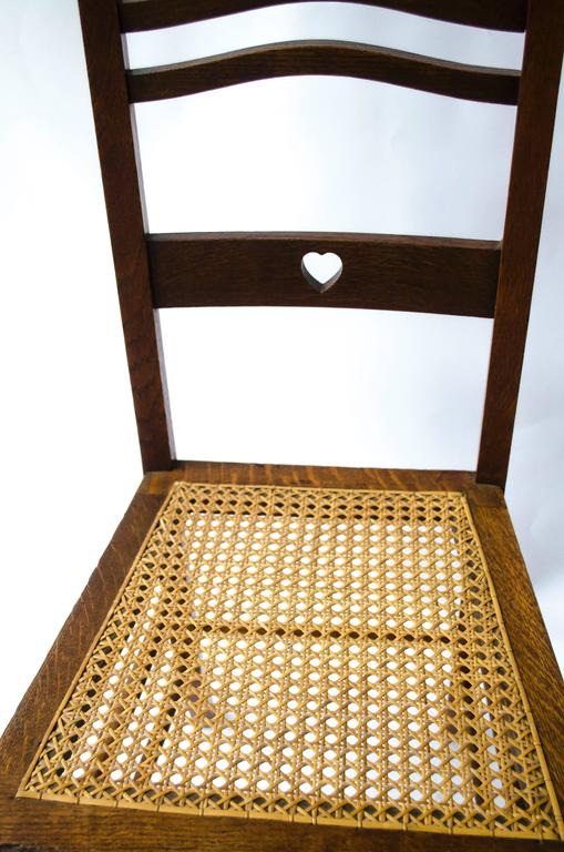 Shapland & Petter An Arts & Crafts Inlaid Oak Side Chair with a Pierced Heart In Good Condition For Sale In London, GB