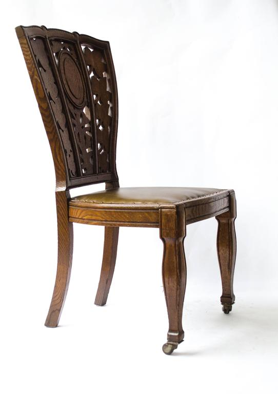 Arthur Heygate Mackmurdo (1851-1942), a highly important oak chair, with an Art Nouveau floral back. Mackmurdo's influence in Europe is recognized as having produced the earliest examples of Art Nouveau, particularly in the styling of a chair-back