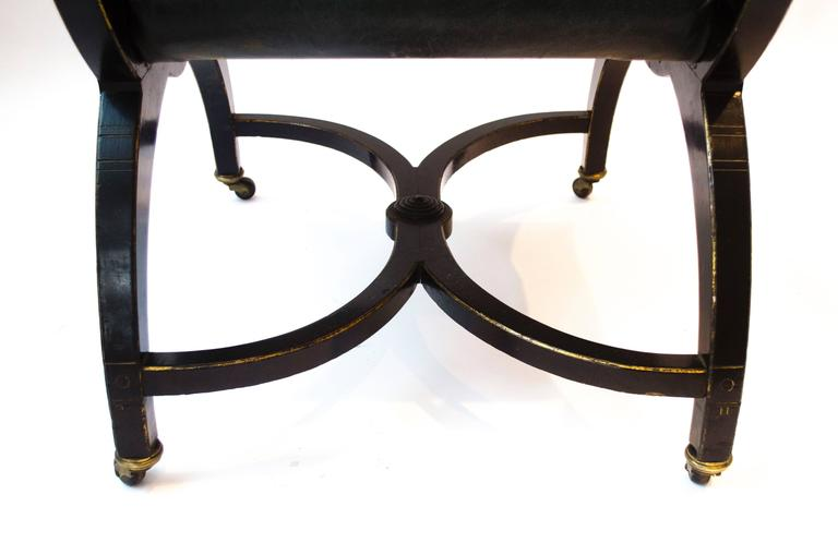 Richard Charles Aesthetic Movement Ebonised Elbow Chair with X Frame stretcher For Sale 6