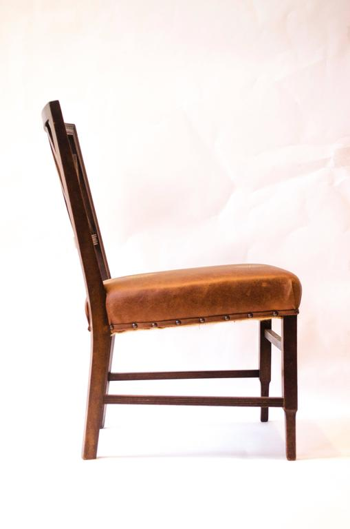 Edward William Godwin (attributed), an Anglo-Japanese walnut side chair, circa 1875, probably by William Watt. With a lattice back, a later overstuffed gilt embossed leather seat, on square part-fluted supports.  See Soros, Susan Weber 'The Secular