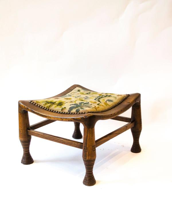 A rare early arts and crafts oak Liberty and Co Thebes stool.