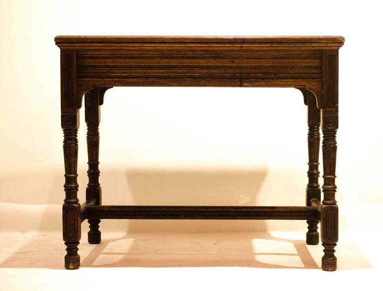 Bruce Talbert for Gillow and Co. A Gothic Revival Oak and Leather Writing Table In Good Condition For Sale In London, GB