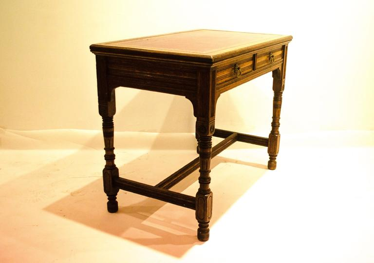 Bruce Talbert (1838-1881) for Gillow and Co., an oak two-drawer writing table, with a later red leather top, stamped mark, no. L9534.