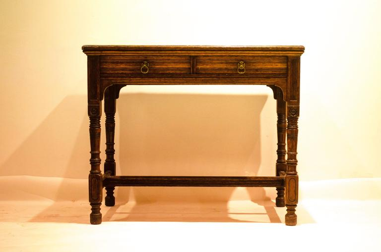 English Bruce Talbert for Gillow and Co. A Gothic Revival Oak and Leather Writing Table For Sale