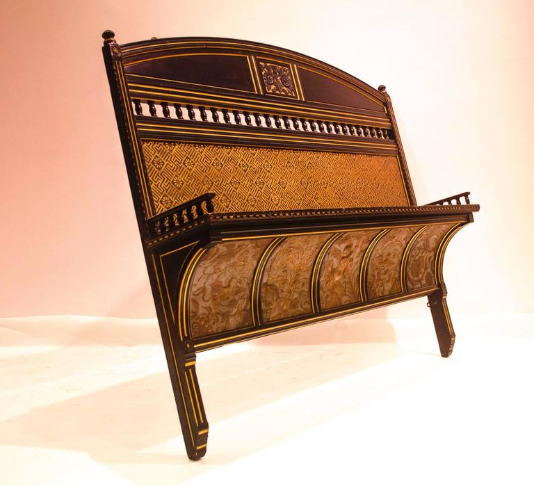 Bruce J Talbert, probably made by Gillows. A rare and outstanding Aesthetic Movement carved and gilt wall shelf with carved florets to the top centre with gilt decoration above the shelf which has turned galleries to each side and exceptional curved