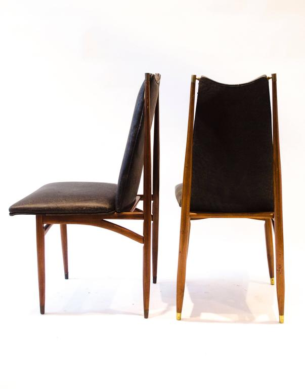 European Set of 12 Mid Century Modern teak Dining Chairs with Decorative Brass Fittings For Sale