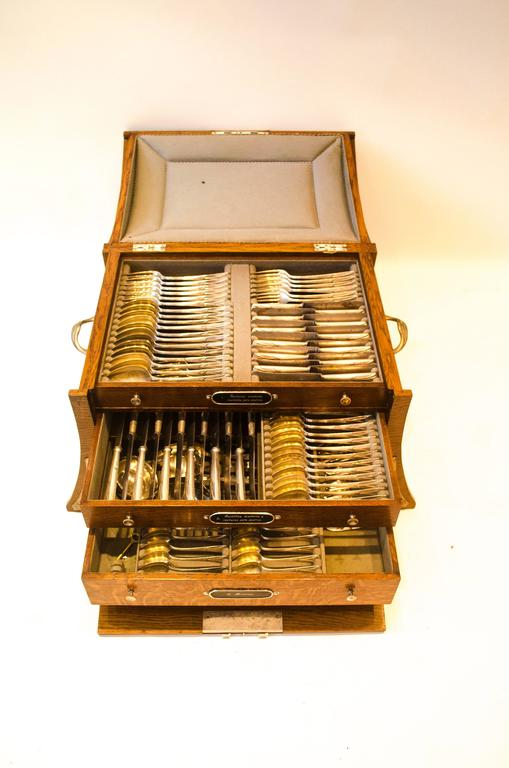 WMF An Art Nouveau silver plated 123 piece cutlery service for 12 in the original cabinet with silver plated stylized mounts. Consisting of:  12 large knives and 12 large forks. 12 smaller knives and 12 smaller forks. 12 large spoons and 12 smaller