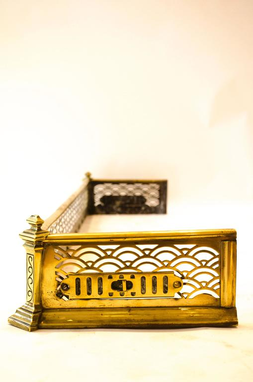 Thomas Jeckyll, made by Barnard Bishop and Barnard. A rare Anglo-Japanese brass fender with pierced Japanese style decoration and adjustable air vents to the sides. This fender relates to the Sunray fireplace fender also by Jeckyll. Jeckyll designed