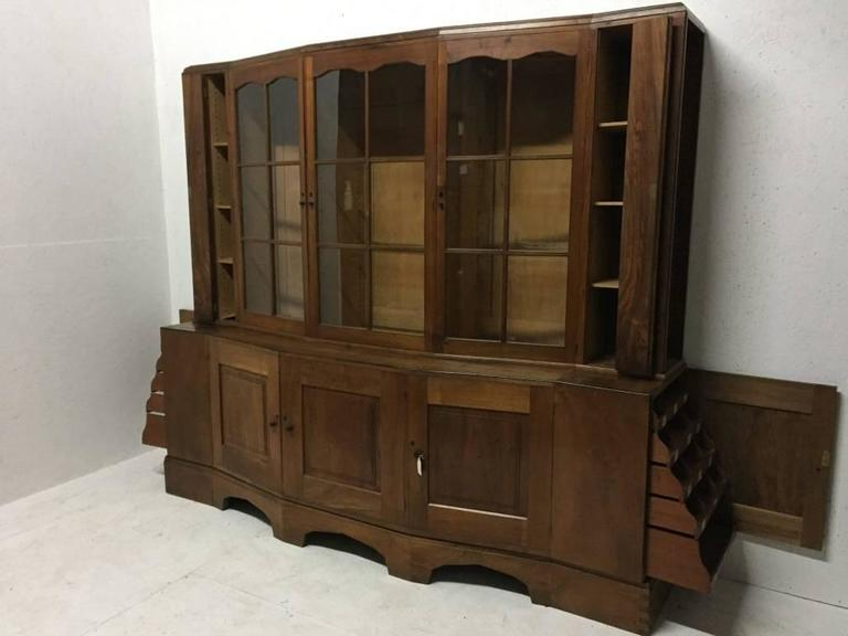 An important Cotswold School walnut breakfront glazed bookcase/cabinet designed by Edward Barnsley, and made by Charles Bray, dated 1932.   Provenance Mrs D.E. Neale, commissioned in 1932.  Exhibited from October to November 1982 by Fischer Fine Art
