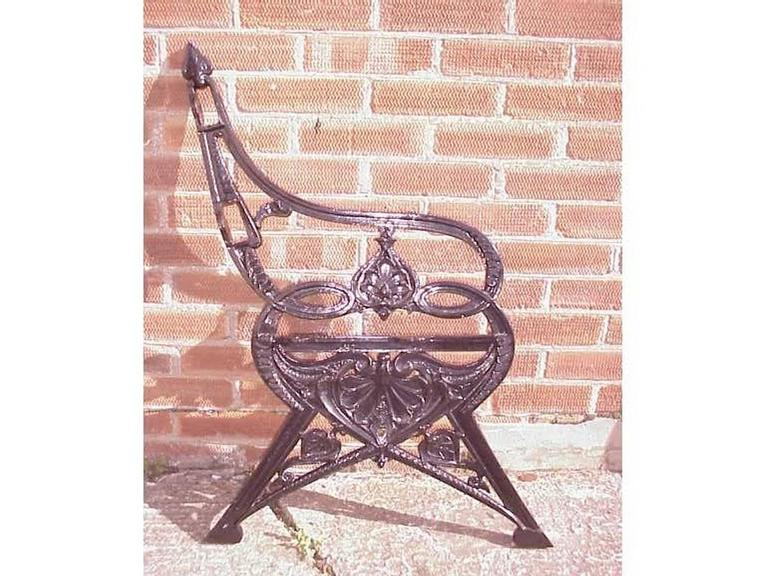 Coalbrookdale, A pair of Victorian cast iron garden benches known as the Lily pad design, with fine fern leaf detailing, on angular legs with smaller Lily style leaves to the legs. Signed C.B.Dale.Co. Registered Design Number No 217569. With a