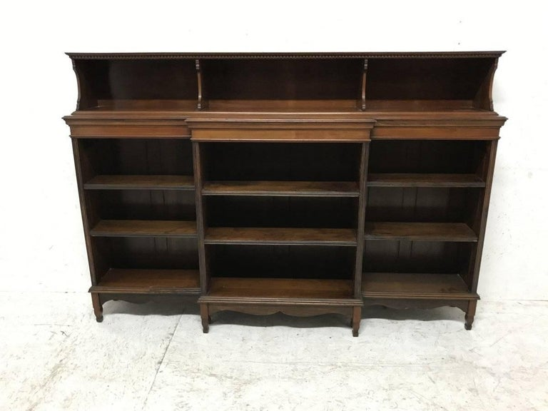 Morris and Co. A fine mahogany Arts and Crafts breakfront bookcase designed by George W Jack An exceptional quality bookcase, what we have come to expect of all Morris and Co furniture.  Line illustrated in Published by Antique Collectors' Club,.