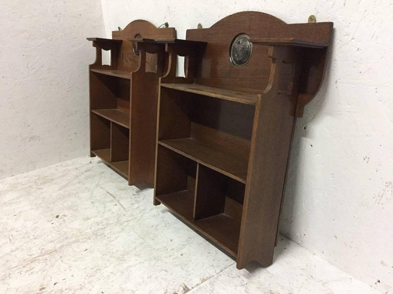 British Shapland and Petter, an Arts & Crafts Hanging Oak Bookcase with Copper Plaque For Sale