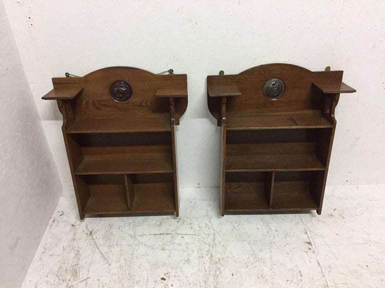 Arts and Crafts Shapland and Petter, an Arts & Crafts Hanging Oak Bookcase with Copper Plaque For Sale