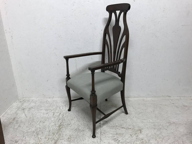 Liberty and Co. A superior quality mahogany armchair in the style of Arthur Heygate MacMurdo with a wonderful Art Nouveau style back and fine Queen Anne style legs.