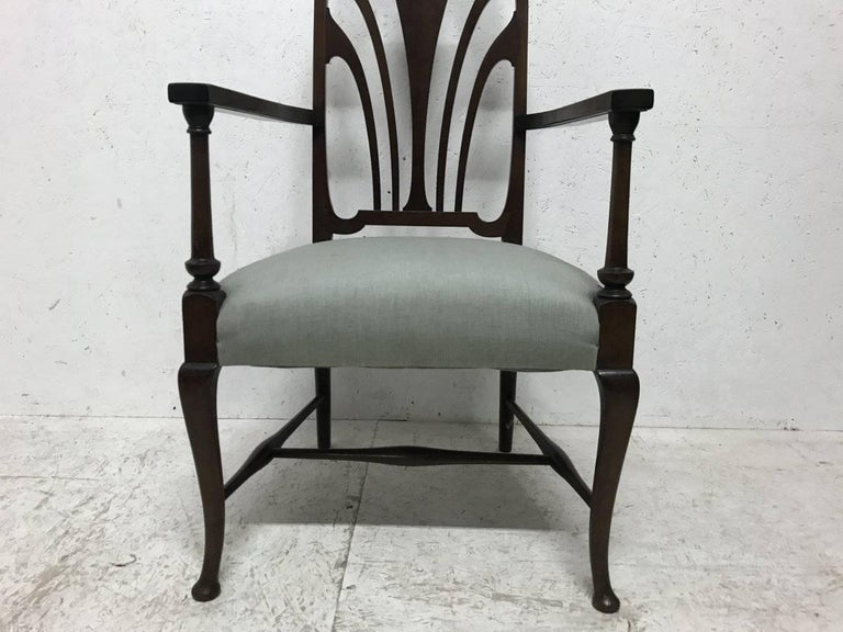 20th Century Liberty & Co. An Arts & Crafts Mahogany Armchair with an Art Nouveau Style Back  For Sale