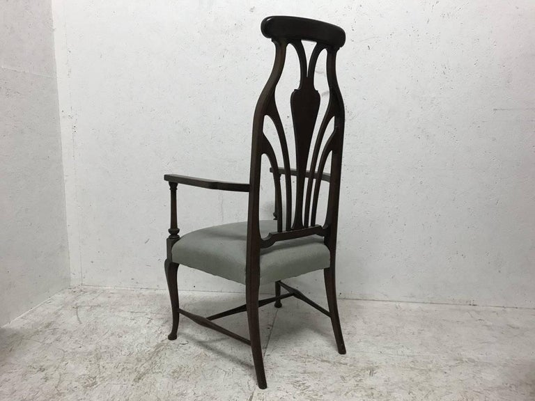English Liberty & Co. An Arts & Crafts Mahogany Armchair with an Art Nouveau Style Back  For Sale