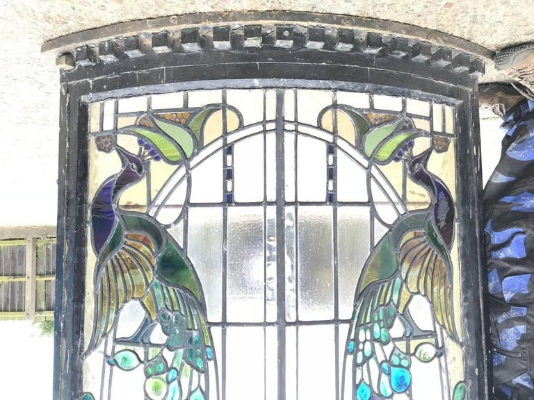 English Rare Arts and Crafts Stained Glass Bow Fronted Window with Colourful Peacocks For Sale