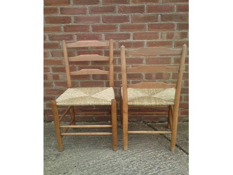 English Edward Gardiner Five Arts & Crafts Ladder Back Dining Chairs with New Rush Seats For Sale