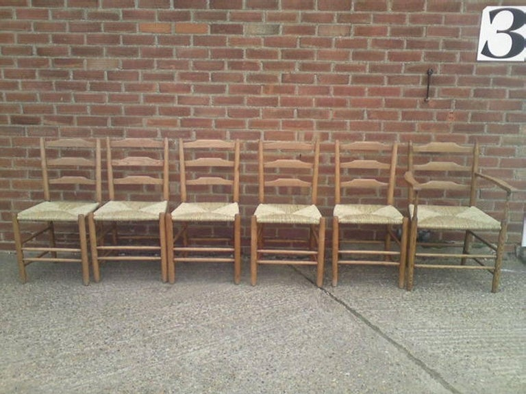 Early 20th Century Edward Gardiner Five Arts & Crafts Ladder Back Dining Chairs with New Rush Seats For Sale