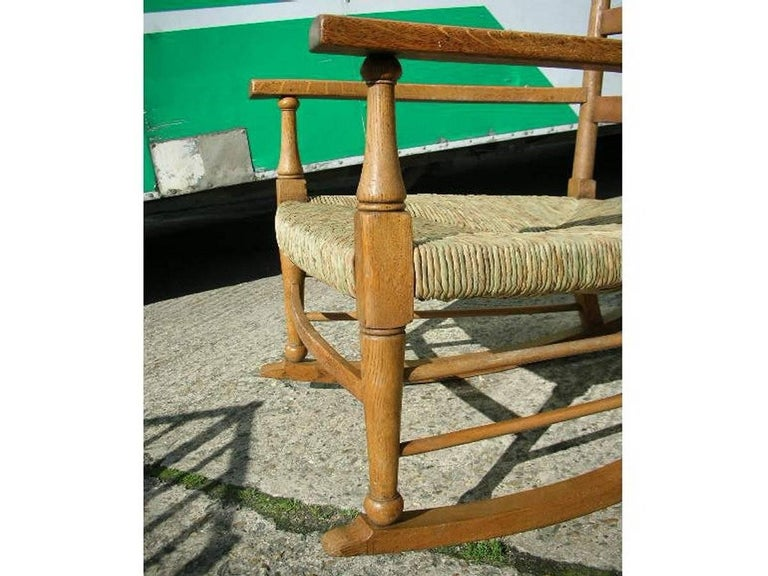 William Birch an Arts & Crafts Light Oak Rocking Chair with Newly Laid Rush Seat In Good Condition For Sale In London, GB