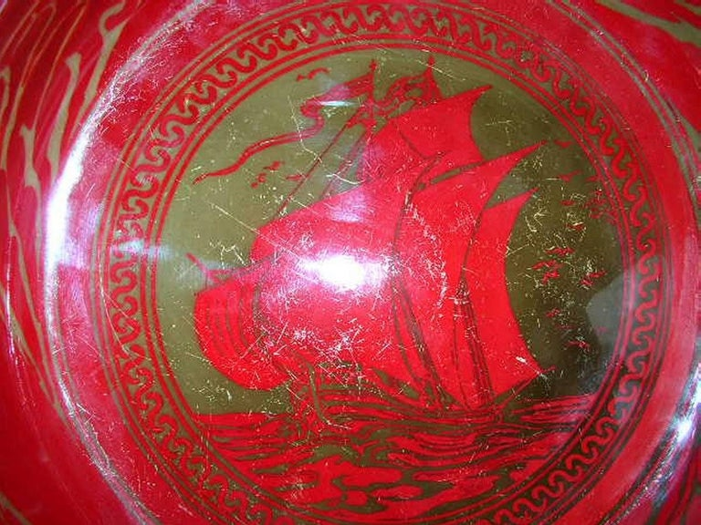 Bernard Moore. A Red Flambe' bowl painted by E. Hope Beardmore with a galleon in full sail on the open sea.  Some surface scratches to the inside.
