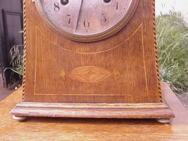Liberty and co attributed an arts and crafts oak mantle for Arts and crafts clocks for sale