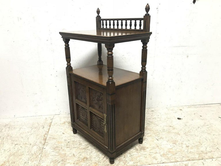 Arts and Crafts Charles Bevan, Gillows & Co. An Aesthetic Oak Cabinet with Carved Birds & Fish For Sale