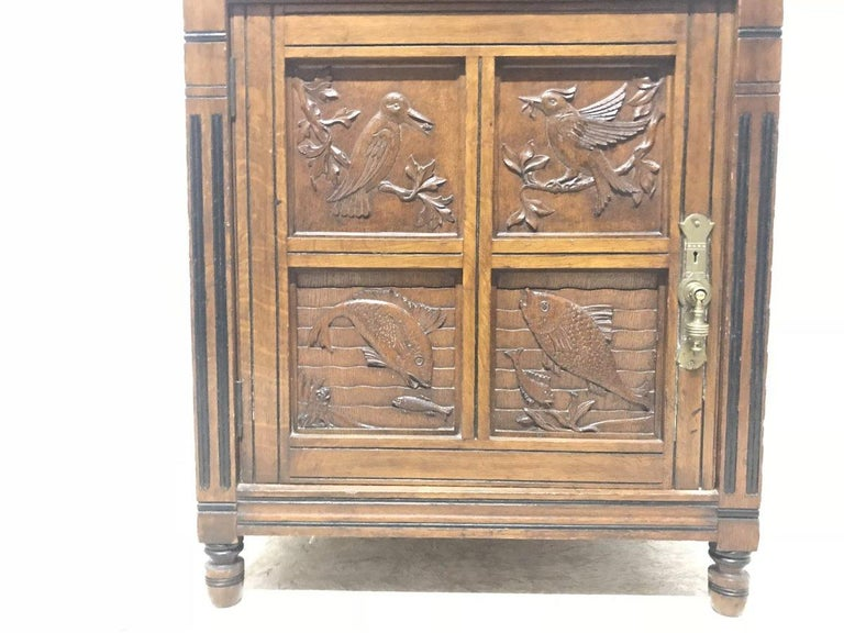 Brass Charles Bevan, Gillows & Co. An Aesthetic Oak Cabinet with Carved Birds & Fish For Sale